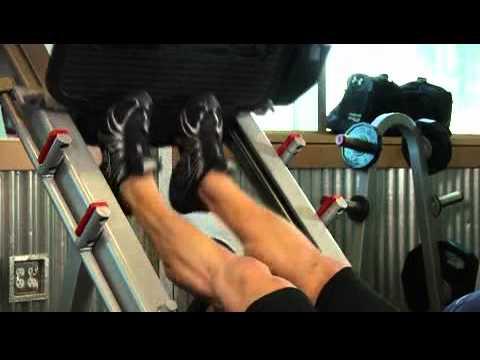 Жим одной ногой в тренажере